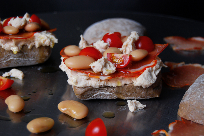 White Bean Hummus, Lomo Prosciutto and Tomato Sandwich
